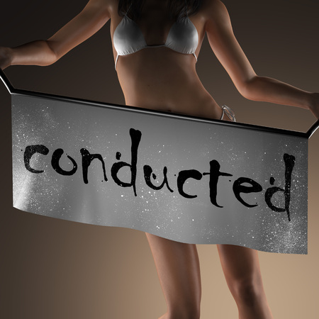 conducted: conducted word on banner and bikiny woman