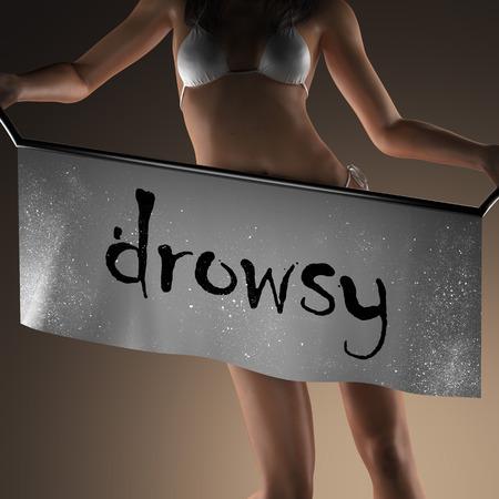 drowsy: drowsy word on banner and bikiny woman Stock Photo