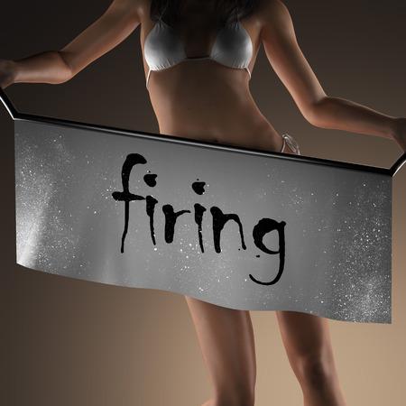 firing: firing word on banner and bikiny woman Stock Photo