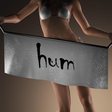hum: hum word on banner and bikiny woman