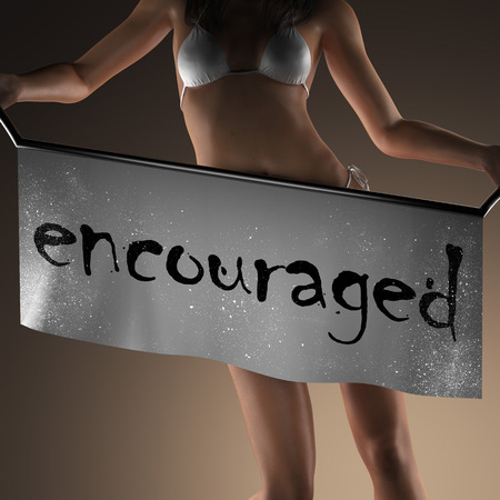 encouraged: encouraged word on banner and bikiny woman Stock Photo
