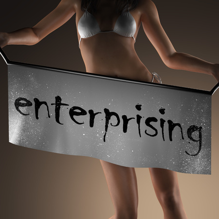 enterprising: enterprising word on banner and bikiny woman Stock Photo