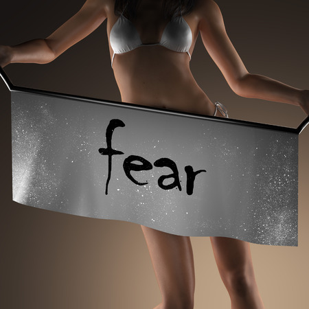 fear: fear word on banner and bikiny woman