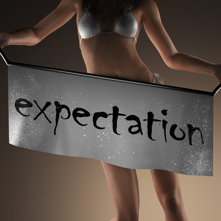 expectation: expectation word on banner and bikiny woman