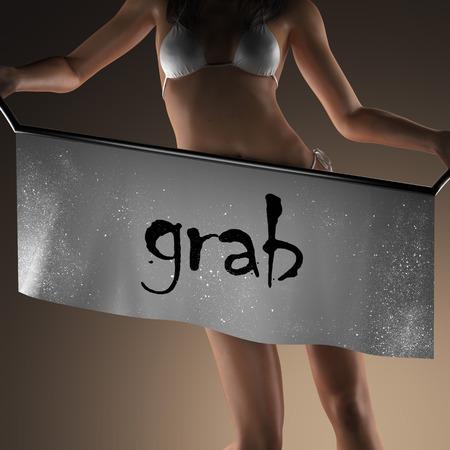 grab: grab word on banner and bikiny woman