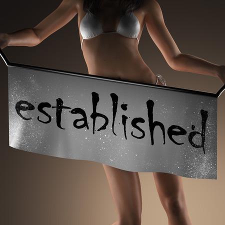 is established: established word on banner and bikiny woman Stock Photo