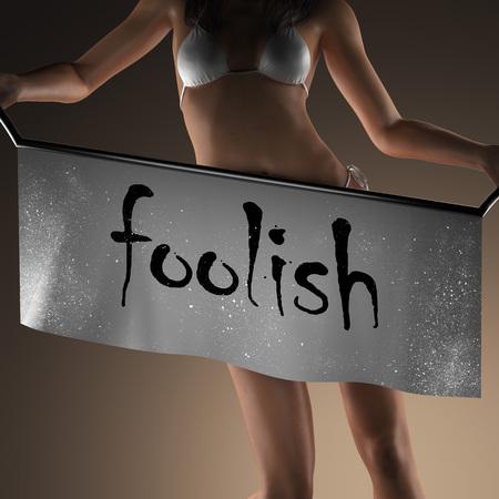 foolish: foolish word on banner and bikiny woman