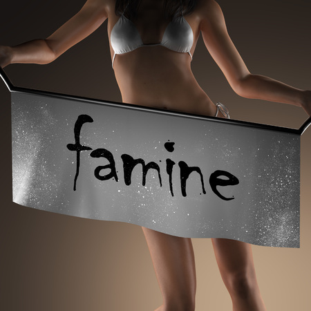 famine: famine word on banner and bikiny woman Stock Photo