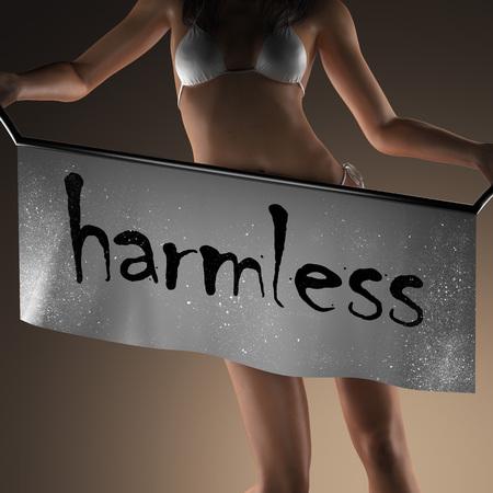 harmless: harmless word on banner and bikiny woman