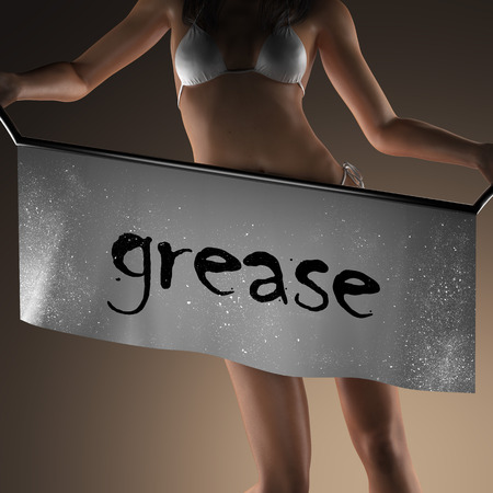 grease: grease word on banner and bikiny woman Stock Photo