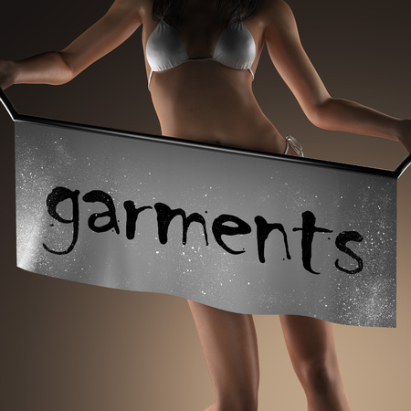 garments: garments word on banner and bikiny woman Stock Photo