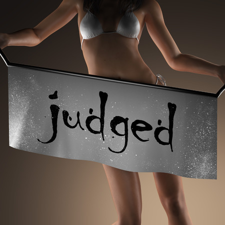 judged: judged word on banner and bikiny woman Stock Photo