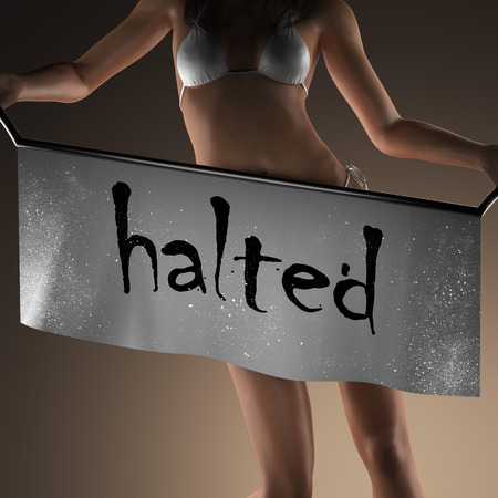 halted: halted word on banner and bikiny woman