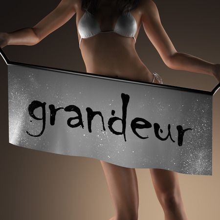 grandeur: grandeur word on banner and bikiny woman