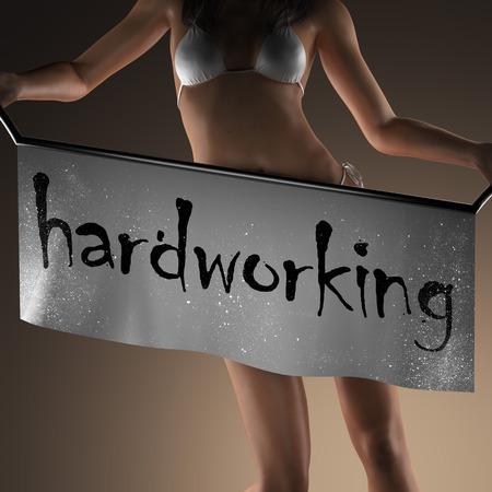 hardworking: hardworking word on banner and bikiny woman Stock Photo