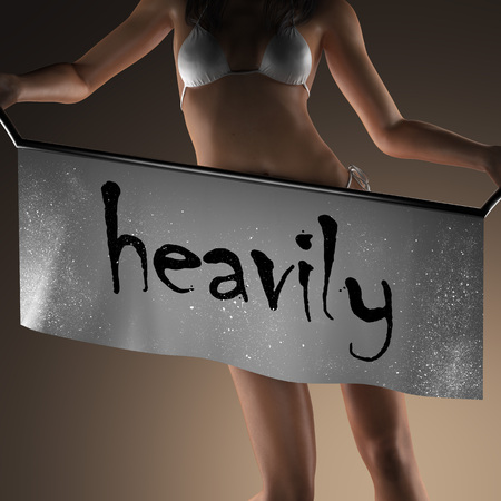heavily: heavily word on banner and bikiny woman