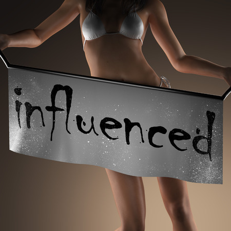 influenced: influenced word on banner and bikiny woman