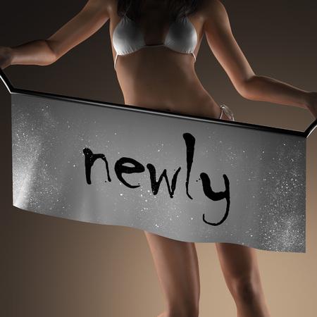 newly: newly word on banner and bikiny woman Stock Photo