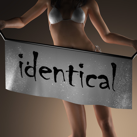 identical: identical word on banner and bikiny woman Stock Photo
