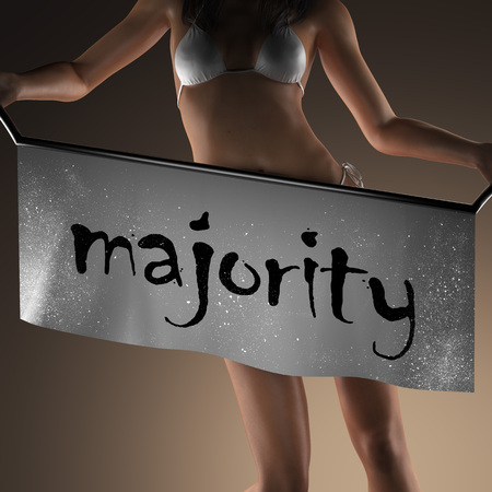 majority: majority word on banner and bikiny woman Stock Photo