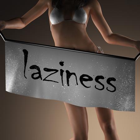 laziness: laziness word on banner and bikiny woman