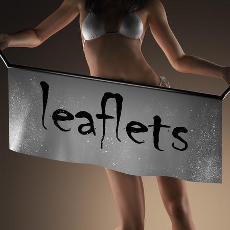 leaflets: leaflets word on banner and bikiny woman