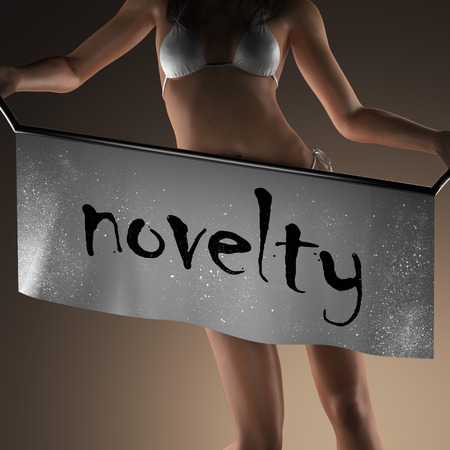 the novelty: novelty word on banner and bikiny woman Stock Photo