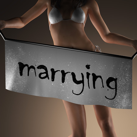 marrying: marrying word on banner and bikiny woman Stock Photo