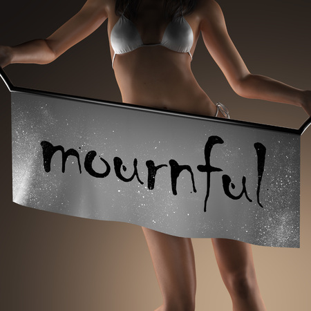 mournful: mournful word on banner and bikiny woman