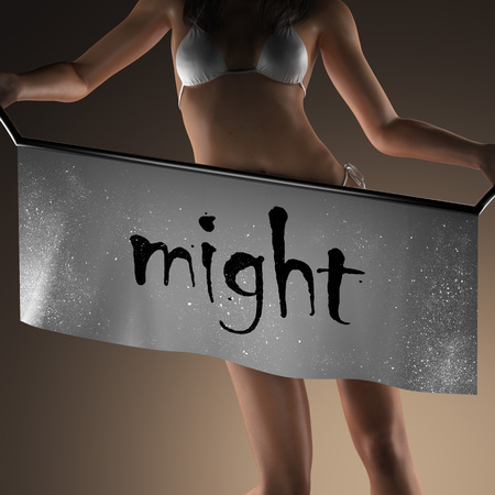 might: might word on banner and bikiny woman Stock Photo