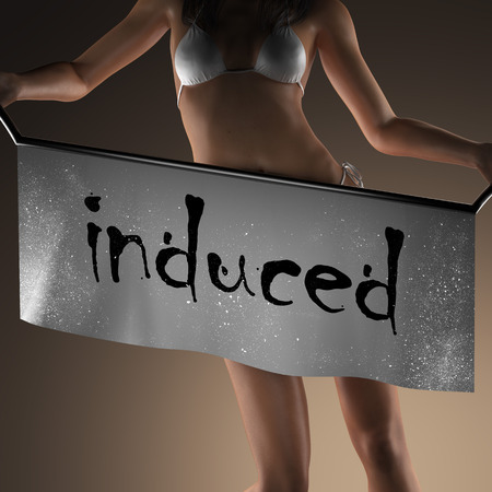induced word on banner and bikiny woman Stock Photo
