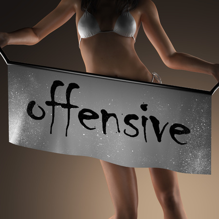 offensive: offensive word on banner and bikiny woman Stock Photo