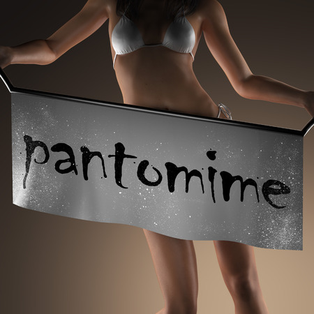 pantomima: pantomime word on banner and bikiny woman Foto de archivo