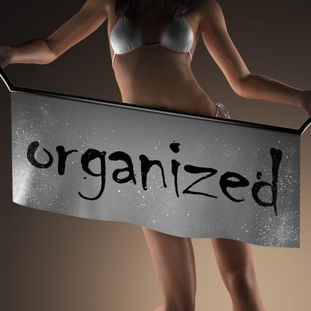 organized: organized word on banner and bikiny woman