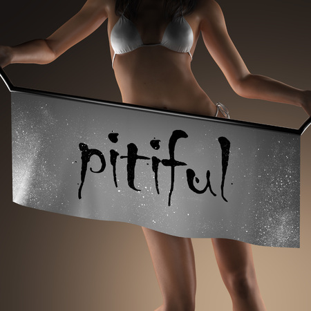 pitiful: pitiful word on banner and bikiny woman