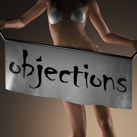 objections: objections word on banner and bikiny woman Stock Photo