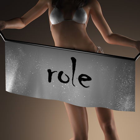 role: role word on banner and bikiny woman Stock Photo