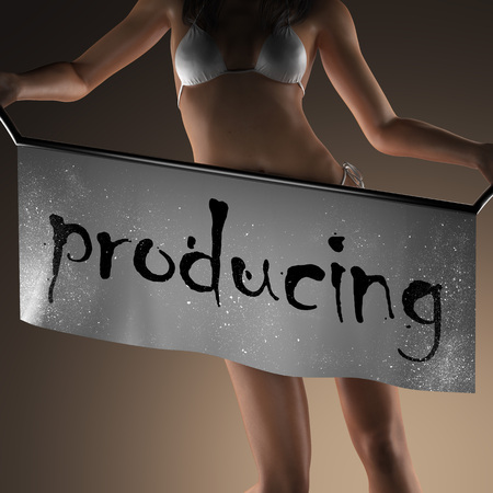 producing: producing word on banner and bikiny woman Stock Photo