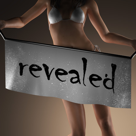 revealed: revealed word on banner and bikiny woman