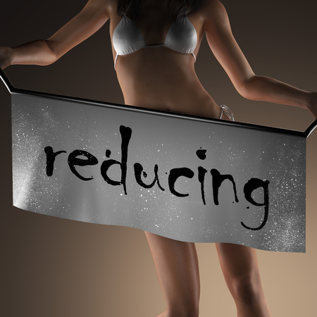 reducing: reducing word on banner and bikiny woman