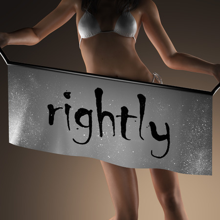 rightly word on banner and bikiny woman Stock Photo