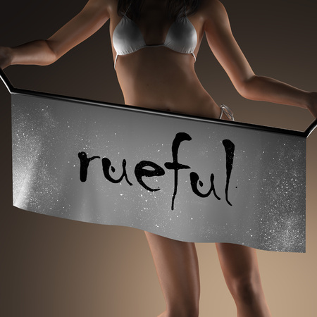 rueful: rueful word on banner and bikiny woman Stock Photo
