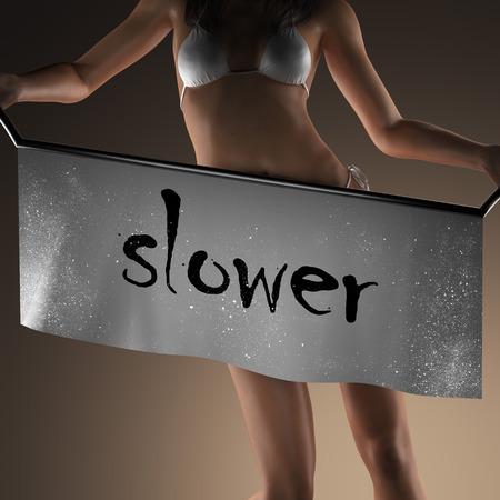 slower: slower word on banner and bikiny woman Stock Photo