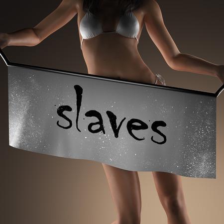 slaves: slaves word on banner and bikiny woman Stock Photo