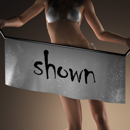 shown: shown word on banner and bikiny woman Stock Photo