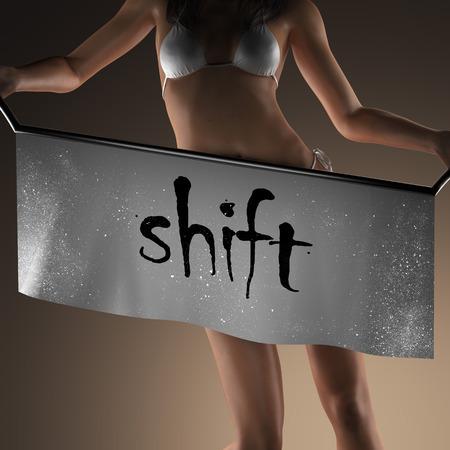 shift: shift word on banner and bikiny woman