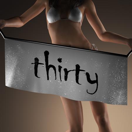 thirty: thirty word on banner and bikiny woman Stock Photo