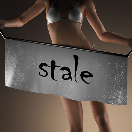 stale: stale word on banner and bikiny woman
