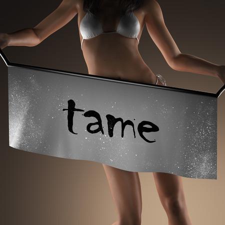 tame: tame word on banner and bikiny woman