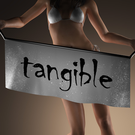 tangible: tangible word on banner and bikiny woman Stock Photo